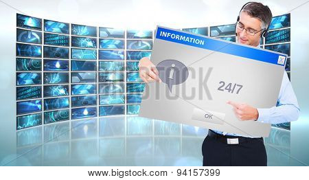 Happy businessman with headphone presenting a panel against info box