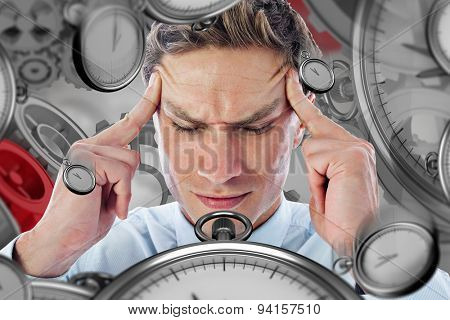 Businessman with a headache against grey vignette