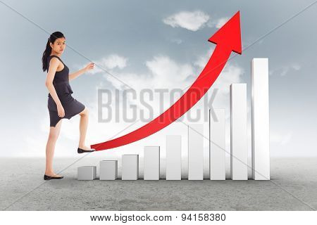 Businesswoman stepping up against cloudy sky background