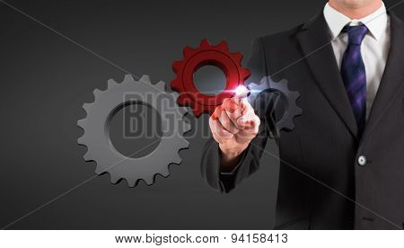 Businessman standing and pointing against grey vignette