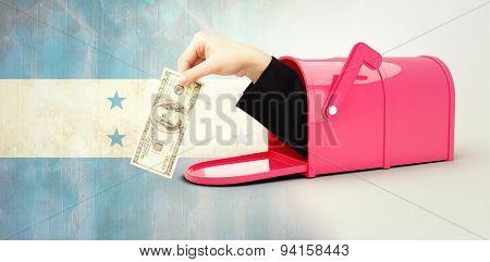 Businesswomans hand holding hundred dollar bill against honduras flag in grunge effect