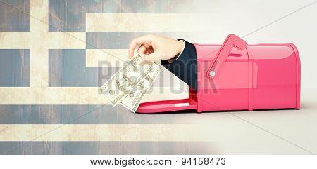 Hand holding hundred dollar bills against greece flag in grunge effect