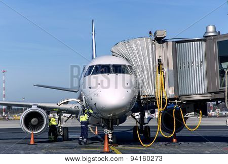 Passenger plane maintenance in airport before flight.