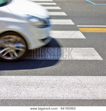 Black And White Pedestrian Crossing With Car On Background