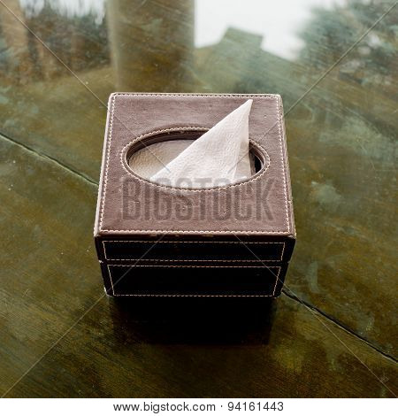 Tissue Box Made From Leather On Glass Desk.