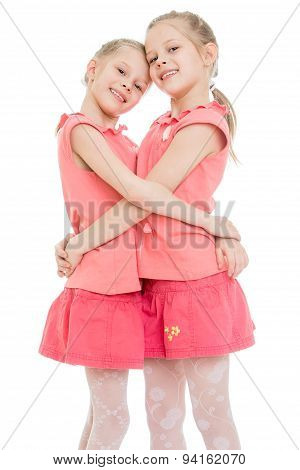 Girls twins hugging, close-up