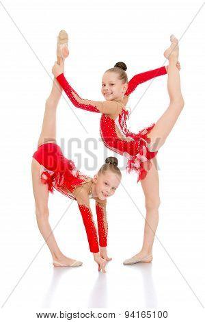 Girls gymnasts perform a beautiful element