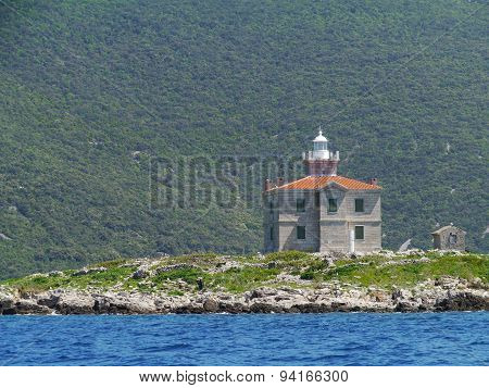 A ligthouse on a island in the Mediterranean