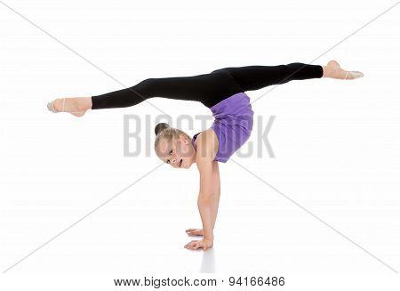 Flexible girl gymnast doing compound exercises