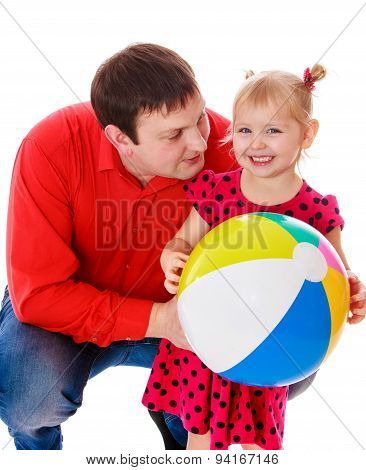 Daddy plays with his beloved daughter