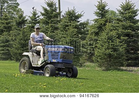 Woman Driving Lawn Mower