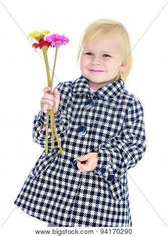 Autumn portrait , blonde girl with bouquet of flowers