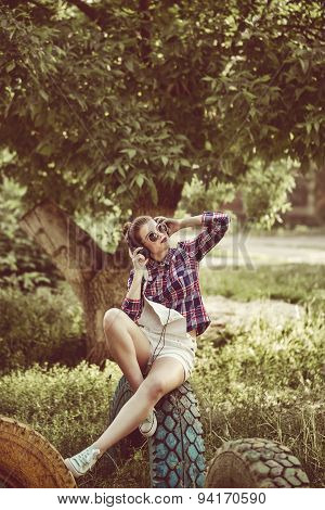 Hipster Girl Enjoying Music With Headphones And Cell Phone.