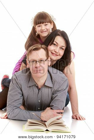 Family portrait, dad mother and daughter reading book