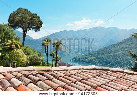 panoramic view of the lake and mountains, terracotta roof