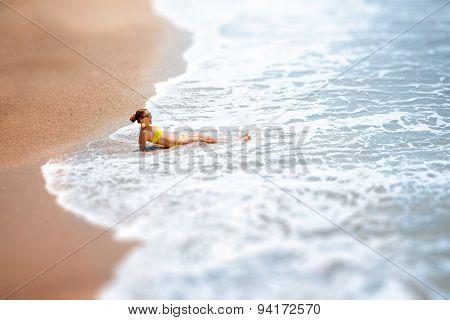Woman lying on the sea coast
