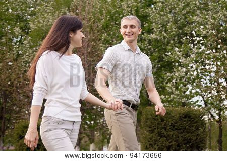 Laughing Couple Walking In Park