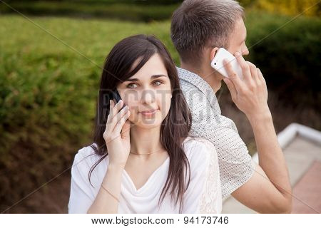 Young Couple Talking On Phone