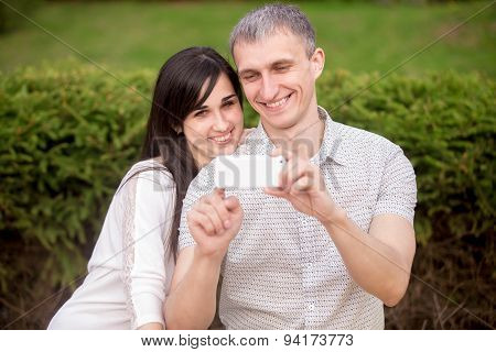 Couple Taking Self Portrait With Phone