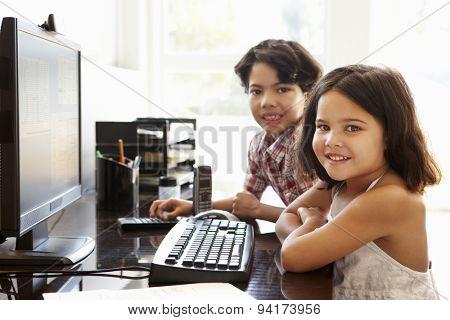 Hispanic children using computer at home