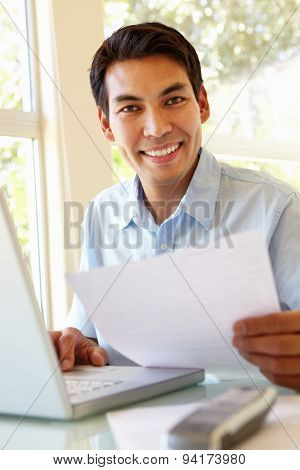 Filipino man working at home