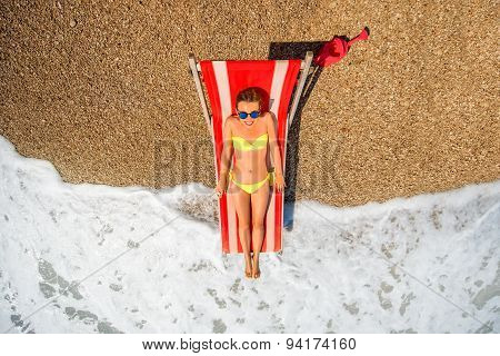 Sunbathing on the red sunbed