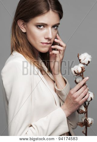 fashion model woman with cotton plant balls in her hands