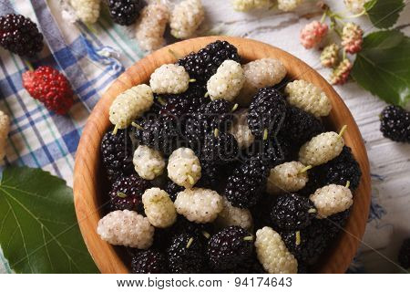 White And Black Mulberries In Bowl Closeup. Horizontal Top View