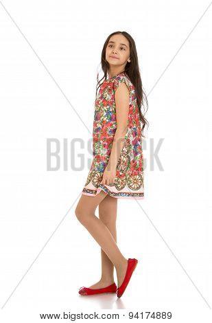 Portrait of slim,handsome, dark-haired girls in short dress