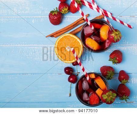 Sangria, Cherries, Strawberries On The Blue Wooden Background