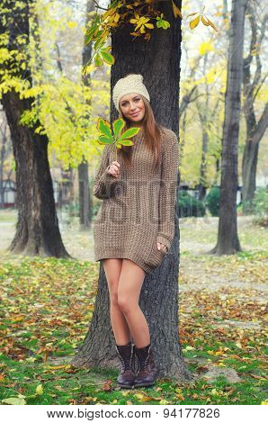 Beautiful Smiling Young Woman Standing In The Autumn Forest