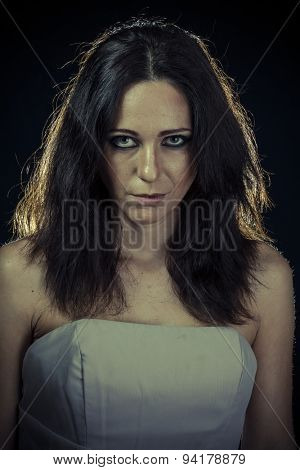 Regret, sad brunette woman with long hair and evening gown