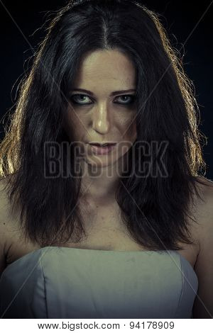 Trouble, sad brunette woman with long hair and evening gown