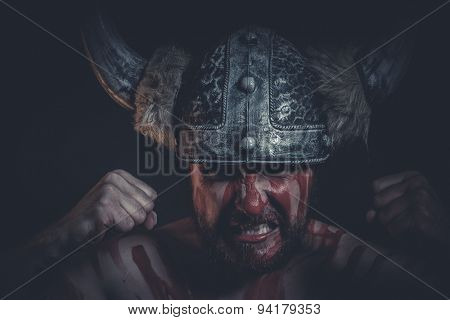 Aggression, Viking warrior with a horned helmet and war paint on his face
