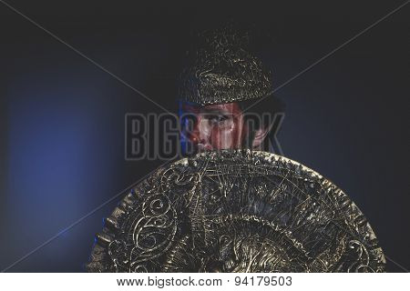 Magic, bearded man warrior with metal helmet and shield, wild Viking