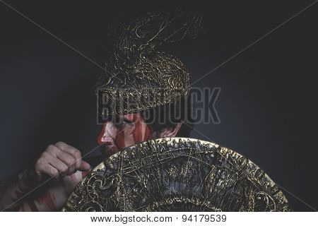 bearded man warrior with metal helmet and shield, wild Viking