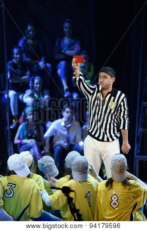ST. PETERSBURG, RUSSIA - JUNE 19, 2015: Football player Alexander Kerzhakov performs in a scene from a children's charity project titled Mowgli Generation. The performance is part of the SPIEF 2015