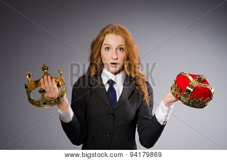 Woman with crowns against background