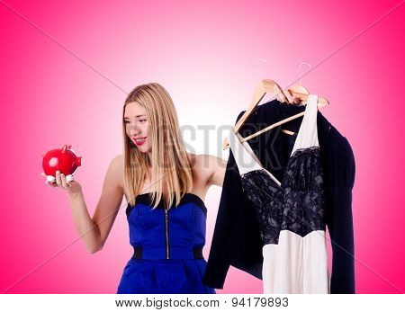 Woman thinking of spending her savings on clothing