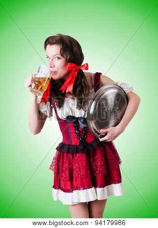 Bavarian girl with tray against the gradient