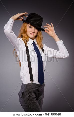 Pretty girl wearing black and white clothing isolated on gray