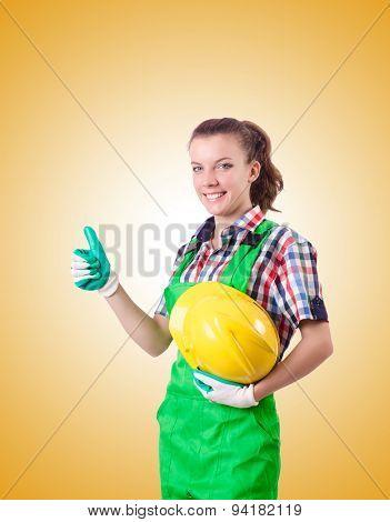 Woman builder against the gradient