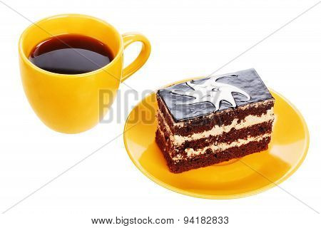 Cup of black tea and chocolate cake