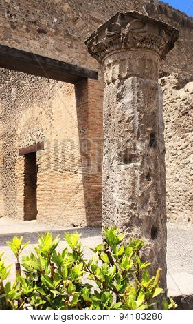 Ancient column and ruins in Pompeii, Italy