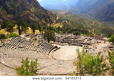 Ancient amphitheater and ruins of Temple of Apollo in the archaeological site of Delphi, Greece