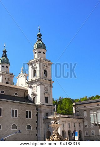 Famous cathedral and Residenzbrunnen fountain on Residenzplats, Salzburg, Austria