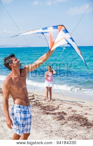 Girl and father with kite