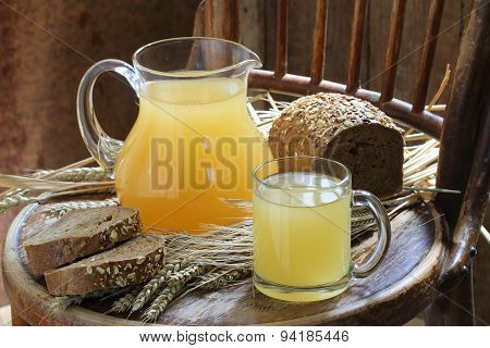 Kvass (kvas) In A Transparent Mug, A Jug And Rye Bread
