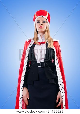 Businesswoman in royal suit against the gradient