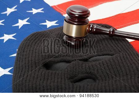 Thief Mask And Judge Gavel Over Us Flag - Studio Shot